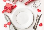 Valentines Day Dinner With Table Place Setting With Red Gift, A Bottle Of Champagne, Hearts With Sil poster