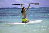 woman on a standup paddle board