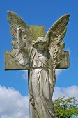image of irish moss  - Pre 1900 stone statue of angel with wings bright blue sky with clouds from a grave in the famous landmark Milltown Cemetery Belfast which is the largest Catholic burial ground in Belfast and synonymous with Irish Republicanism - JPG
