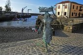 PUERTO DE LA CRUZ, SPAIN - JUNE 15: A sculpture of a fishwife in the fishing port on June 15, 2011 i