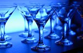 Wineglasses on the table in blue light