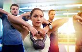 sport, fitness, weightlifting and training concept - group of people with kettlebells and heart-rate poster