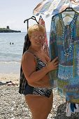 pic of peddlers  - A woman at the beach near a peddling stall - JPG
