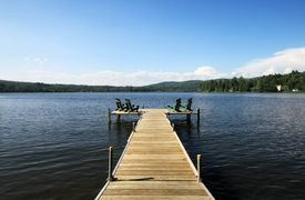 pic of dock a lake  - Lake side deck with chairs and summer sunshine - JPG