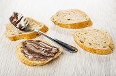 Slices Of Bread, Sandwich With Chocolate-nut Paste, Spoon With Paste On Wooden Table poster