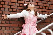 picture of lolita  - stressed japanese lolita  leaning against brick wall on stairs - JPG