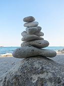 Beach Stone Zen Cairn. A Stone Pyramid On Sea Shore. Simple Poise Pebbles Stack, Rock Zen Sculpture, poster
