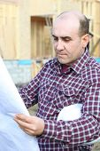 Housebuilder looking at plans on site