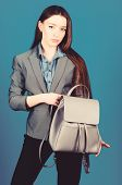Woman With Leather Knapsack. Stylish Woman In Jacket With Leather Backpack. Formal Style Accessories poster