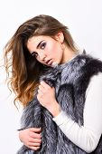 Girl Makeup Face Long Hairstyle Wear Fur Vest White Background. Luxury Fur Accessory. Fashion Trend  poster