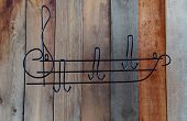 An Original Clothes Hanger In The Form Of A Musical Staff With A Treble Clef, Made Of Metal, Painted poster