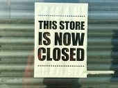 This store is now closed sign in glass shop front window poster
