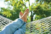 Young Woman Resting In Comfortable Hammock At Green Garden, Closeup poster