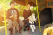 Blurred View Of Two Happy Young Teenagers Enjoying Roller Coasters. Two Playful Adults With Inner On poster