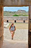 Backpacker girl visiting Uxmal, Mexico - Mayan ruins