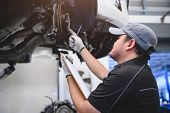 Asian Male Car Technician Car Maintenance For Customers According To Specified Vehicle Maintenance C poster