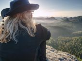 Woman Hiker With Leather Hat Conquer Highest Peak. Woman Hiker Traveling Alone In Nature. Mountain L poster