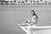 Honeymoon Cruise Ship. Wedding Ceremony Sea Cruise. Bride Adorable White Wedding Dress Sunny Day Sit poster