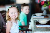 Portrait of adorable little girl at restaurant