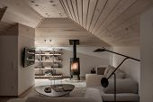 Light Illuminated Interior With Sloping Wooden Ceiling poster