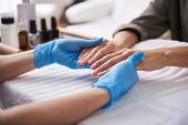 Professional Manicurist Checking Lady Fingernails In Beauty Salon poster