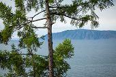 Angara River At Lake Baikal In Listvyanka Village. Summer Landscape On Port Baikal With Mountain Che poster