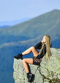 Extreme Concept. On Edge Of World. Woman Sit On Edge Of Cliff In High Mountains Landscape Background poster