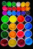 several color plastisol ink cans in factory who use plastisol ink to print tee shirt and print on fa poster