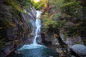 Senga Waterfall ( Sengataki ), A Waterfall In Mitake Shosenkyo Gorge. Autumn Foliage Scenery View In poster