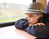 Pensive Teenage Boy At The Window In The Carriage
