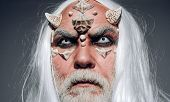Tree Spirit And Fantasy Concept. Man Wizard With Fantastic Make Up On Demon Face. Horror And Fantasy poster