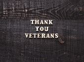 Beautiful Greeting Card On Veterans Day. Top View. poster