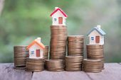 Saving Money Concept, Coin Stack Growing Business, Save Money For Investment. Coins To Buy A Home Co poster