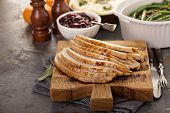 Sliced Turkey On A Cutting Board For Thanksgiving Or Christmas Dinner Table poster