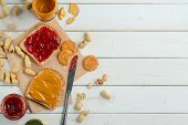Fantastic Jelly And Peanut Butter Sandwich, Jars, Knife, Top-view. Light Wooden Background, Place To poster