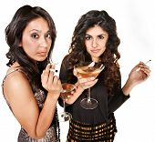 stock photo of spoiled brat  - Young Hispanic club girls with cigarettes and alcohol - JPG