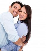 Beautiful affectionate couple smiling - isolated over a white background