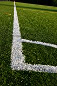 foto of shiting  - The corner kick area on an artificial soccer field