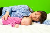 foto of have sweet dreams  - Mother and daughter have sweet dreams on green background - JPG
