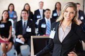 Businesswoman Delivering Presentation At Conference