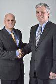 Businessmen concluding corporate partnership