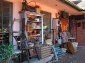 picture of bartering  - antique shoppe with colectibles displayed outside - JPG