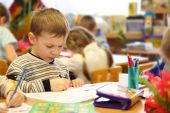 Boy Draws In Kindergarten