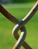 pic of chain link fence  - Detail of rusty chain - JPG