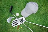 Golf equipment on green grass