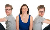 image of identical twin girls  - Identically adult male twins with girl  in studio - JPG