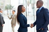 image of handshake  - professional african business people handshaking in office - JPG