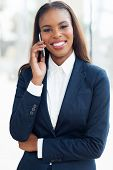 portrait of young african american businesswoman using cell phone
