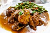 Red wine cock-delicious french recipe coq au vin