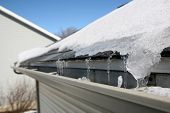 stock photo of gutter  - Ice on roof and gutters - JPG